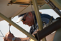 Pilot Kermit Weeks makes adjustments before display of Albatros DV.a